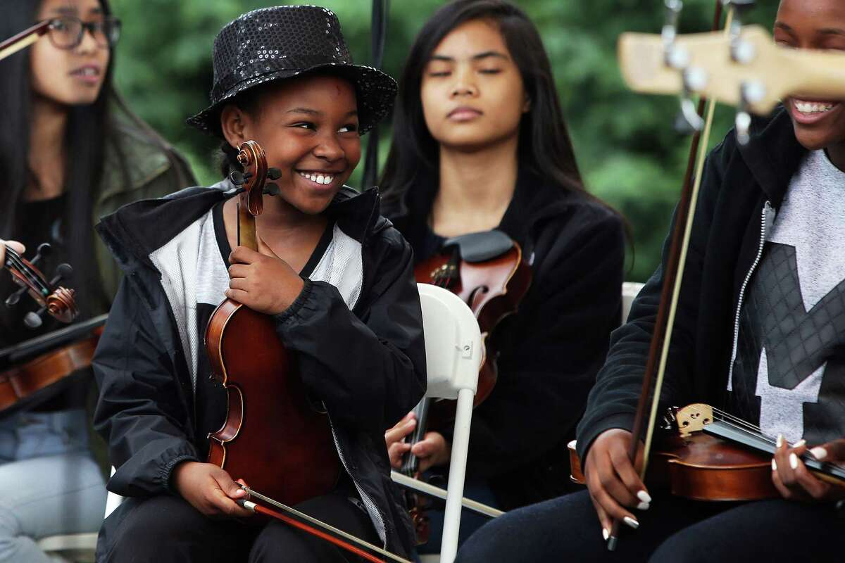 Members of the Southeast Seattle Community Youth Orchestra perform during the 2016 Northwest Folklife Festival at Seattle Center, May 29, 2016.