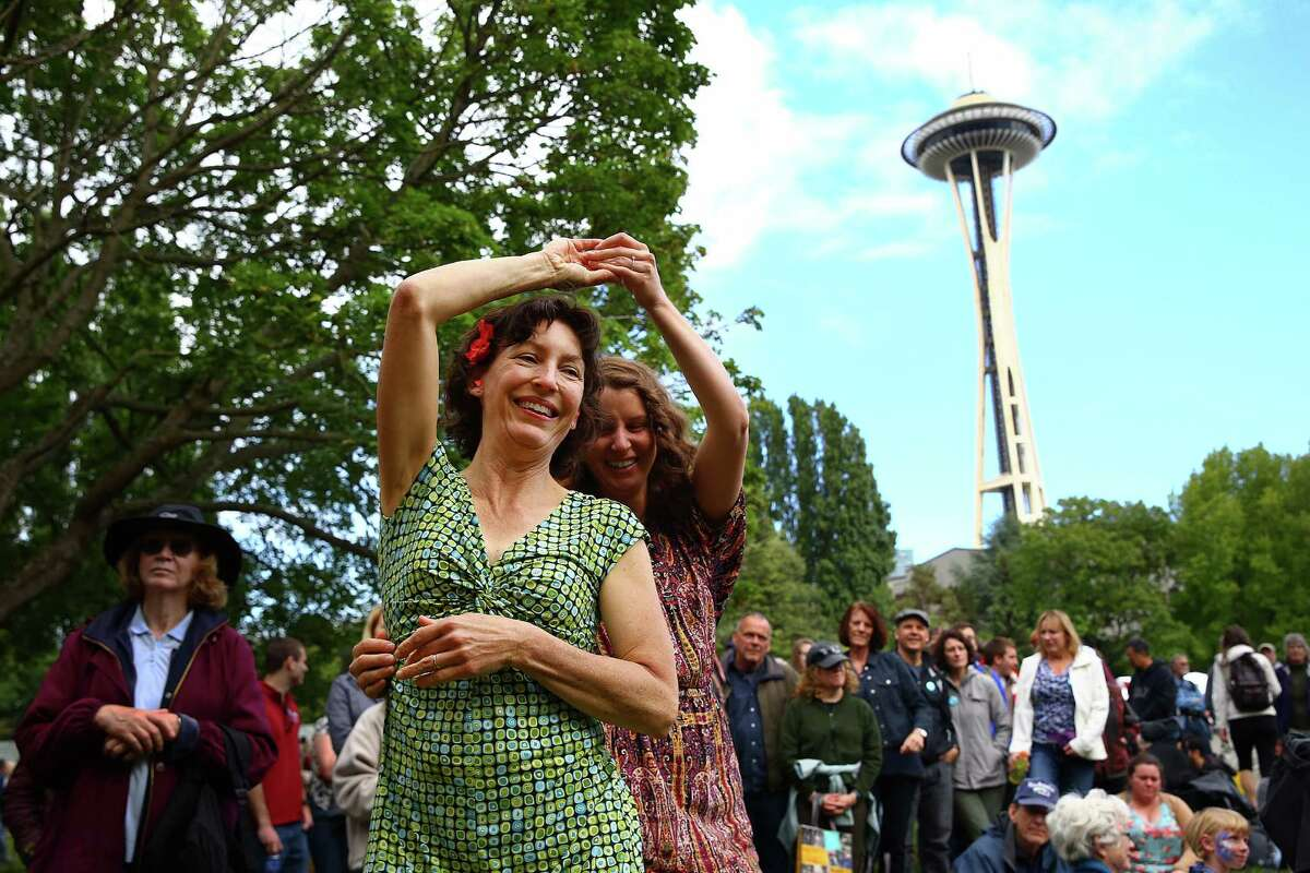 Margot Richardson and Julia Tobin dance to the music of Wylie and the Wild West during the 2016 Northwest Folklife Festival at Seattle Center, May 29, 2016.