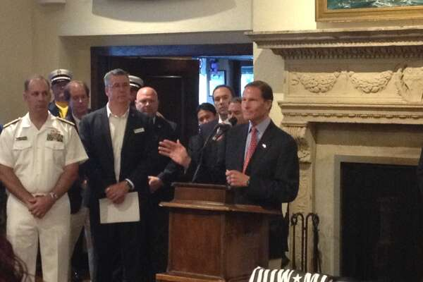 U.S. Sen. Richard Blumenthal makes a point about veterans' health-care services at a Memorial Day gathering.
