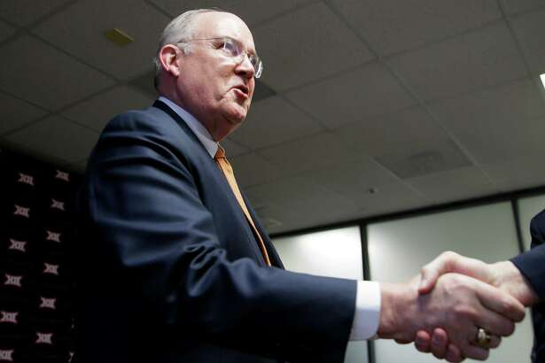 Texas athletic director Mike Perrin shakes hands after the Big 12 conference meetings on Feb. 4, 2016, in Irving.