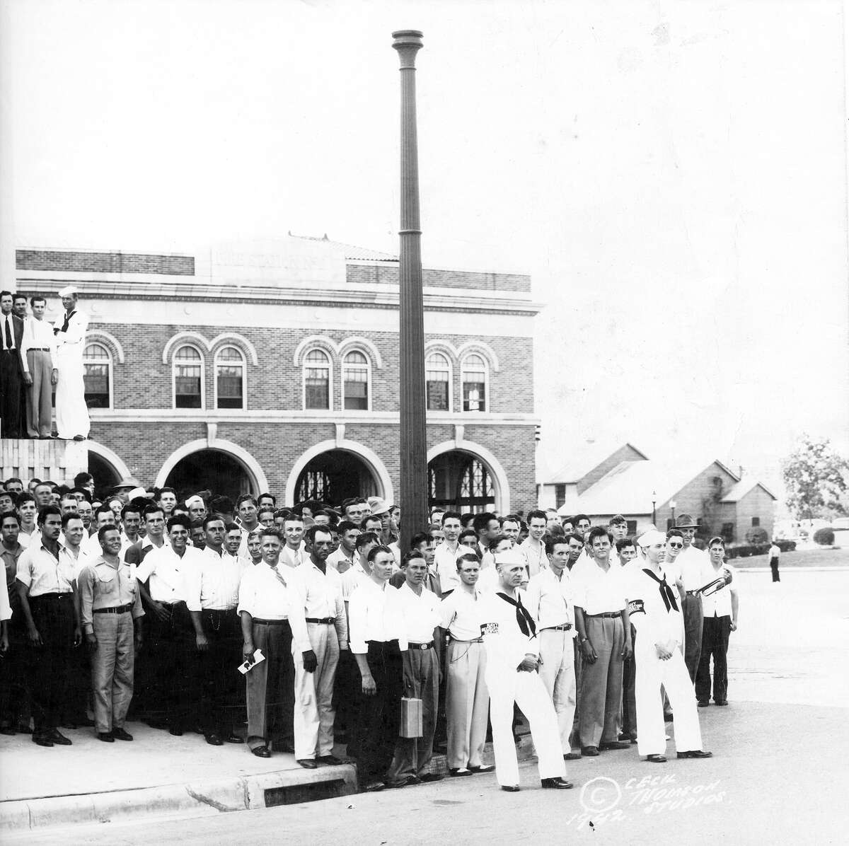 The Houston Volunteers on Memorial Day, May 30, 1942, outside the Music Hall/Sam Houston Coliseum. Fire Station No. 2 can be seen in the background.