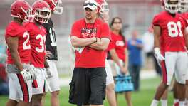 Houston head coach Tom Herman looks on as his players warm up during the Cougars' opening spring practice Monday, March 7, 2016, in Houston.