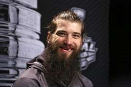 San Jose Sharks' Brent Burns talks to reporters during Stanley Cup Finals Media Day at the Consol Energy Center in Pittsburgh, Sunday May 29, 2016. The Sharks face-off in Game 1 of the Stanley Cup Finals against the Pittsburgh Penguins on Monday, May 30, in Pittsburgh. (AP Photo/Gene J. Puskar)