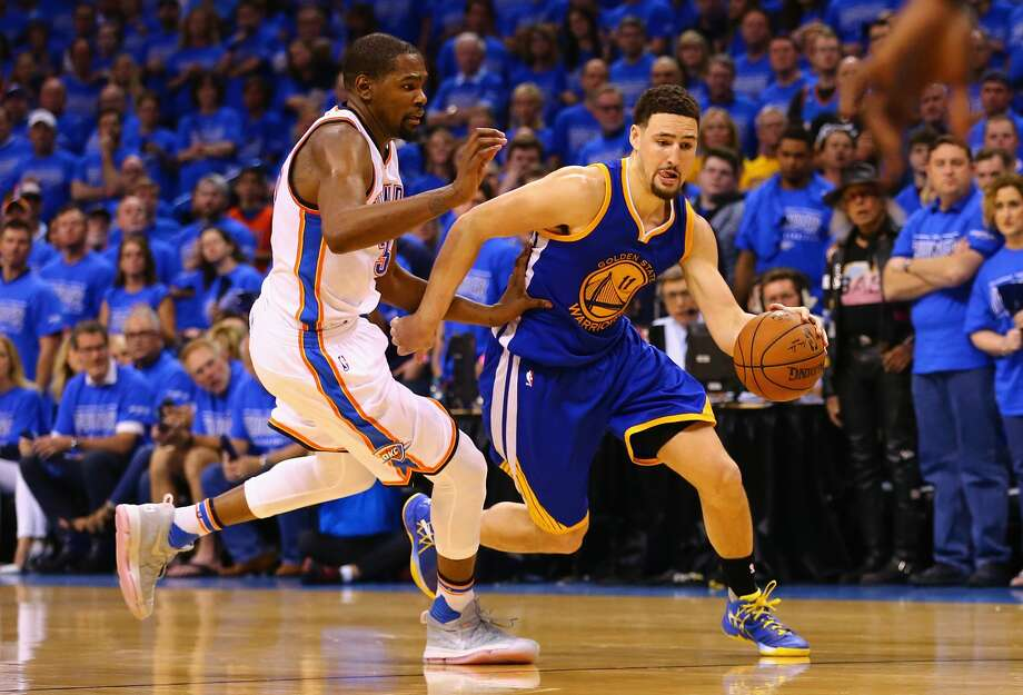 OKLAHOMA CITY, OK - MAY 28: Klay Thompson #11 of the Golden State Warriors drives against Kevin Durant #35 of the Oklahoma City Thunder during the fourth quarter in game six of the Western Conference Finals during the 2016 NBA Playoffs at Chesapeake Energy Arena on May 28, 2016 in Oklahoma City, Oklahoma.