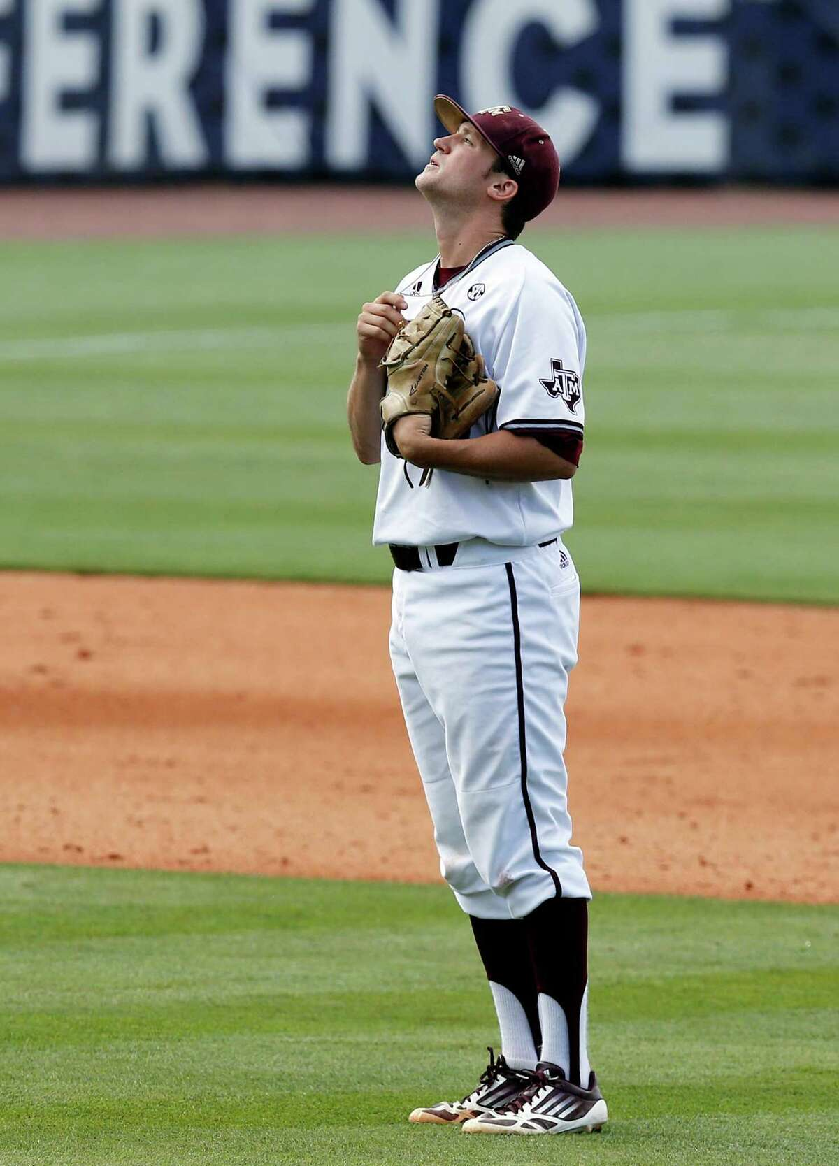 Texas A&M's Andrew Vinson looks up to the sky before pitching in the seventh inning of the Southeastern Conference NCAA college baseball championship game at the Hoover Met, Sunday, May 29, 2016, in Hoover, Ala. Texas A&M won 12-5. (AP Photo/Brynn Anderson)