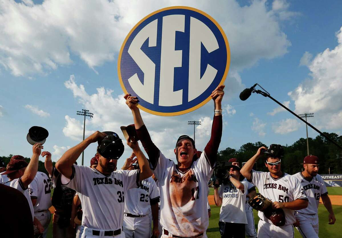 Texas A&M's players celebrate their win over Florida after the Southeastern Conference NCAA college baseball championship game at the Hoover Met, Sunday, May 29, 2016, in Hoover, Ala. (AP Photo/Brynn Anderson)