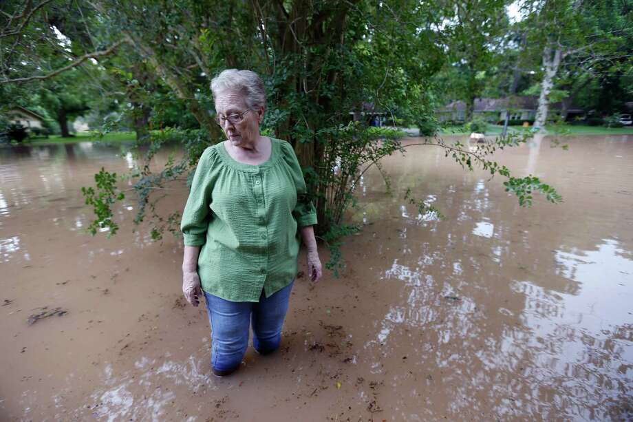 Anice Divin, 71, walks just feet from her front porch at Greenwood and Strange Drive Monday, May 30, 2016, in Richmond. Divin has lived in the area for 49 years and never seen water up to her home before this weekend. Photo: Karen Warren, Houston Chronicle / © 2016 Houston Chronicle