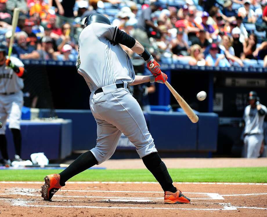 ATLANTA, GA - MAY 30: Brandon Belt #9 of the San Francisco Giants hit a second inning solo home run against the Atlanta Braves at Turner Field on May 30, 2016 in Atlanta, Georgia. (Photo by Scott Cunningham/Getty Images) Photo: Scott Cunningham, Getty Images