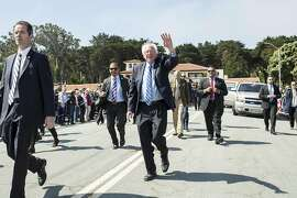 Bernie Sanders, a candidate for the Democratic nomination for President of the United States, waves to the crowd while walking the parade route during the annual Memorial Day Ceremony at the San Francisco National Cemetery in the Presidio in San Francisco, Calif., on Monday, May 30, 2016.