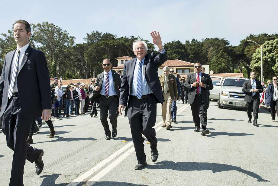 Bernie Sanders, a candidate for the Democratic nomination for President of the United States, waves to the crowd while walking the parade route during the annual Memorial Day Ceremony at the San Francisco National Cemetery in the Presidio in San Francisco, Calif., on Monday, May 30, 2016. Photo: Laura Morton, Special To The Chronicle