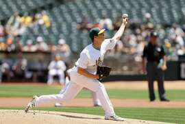 OAKLAND, CA - MAY 29:  Rich Hill #18 of the Oakland Athletics pitches against the Detroit Tigers in the first inning at the Coliseum on May 29, 2016 in Oakland, California.  (Photo by Ezra Shaw/Getty Images)