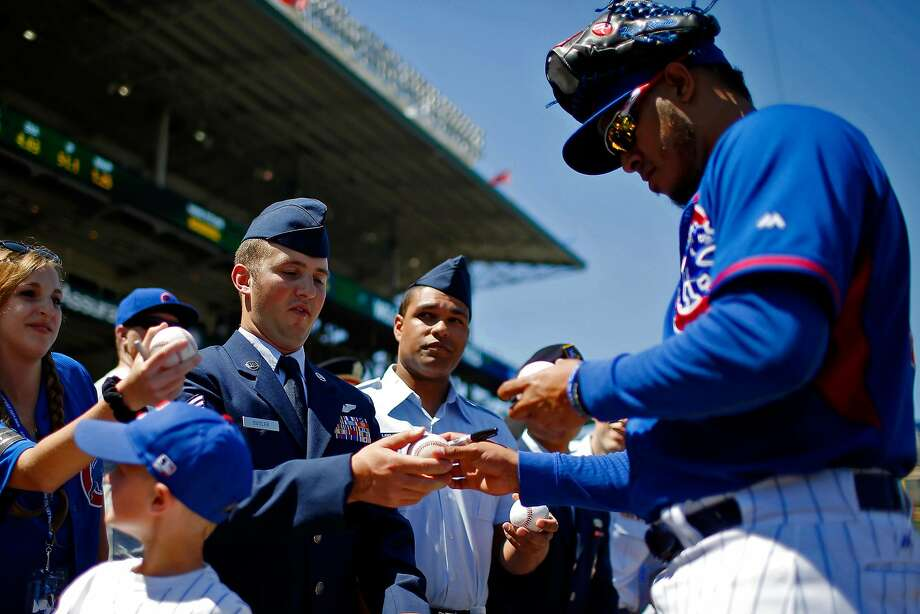 The Chicago Cubs and Hector Rondon (right) began their week with a Memorial Day tribute to veterans before their game against the Los Angeles Dodgers at Wrigley Field. Photo: Jon Durr, Getty Images
