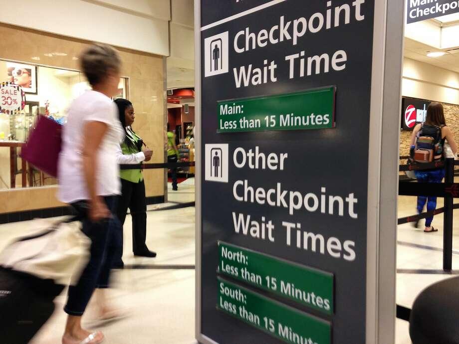 Passengers enter a security checkpoint at Atlanta's Hartsfield-Jackson International Airport. Photo: Kathleen Foody, Associated Press