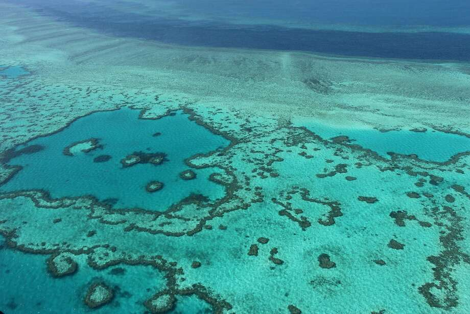 FIL-- This photo taken on November 20, 2014 shows a flight view of the Great Barrier Reef off the Whitsunday Islands coast along Queensland's central coast. Coral reefs, which the Tara Pacific expedition begins studying on May 28, 2016 in the Pacific Ocean, are