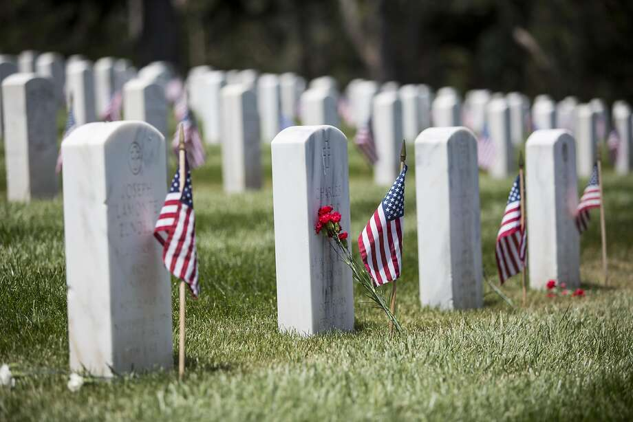Flags and flowers placed on graves during the annual Memorial Day Ceremony at the San Francisco National Cemetery in the Presidio, May 30, 2016. Photo: Laura Morton, Special To The Chronicle
