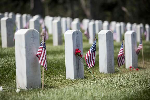 Flags and flowers were placed on graves during the annual Memorial Day Ceremony at the San Francisco National Cemetery in the Presidio in San Francisco, Calif., on Monday, May 30, 2016.