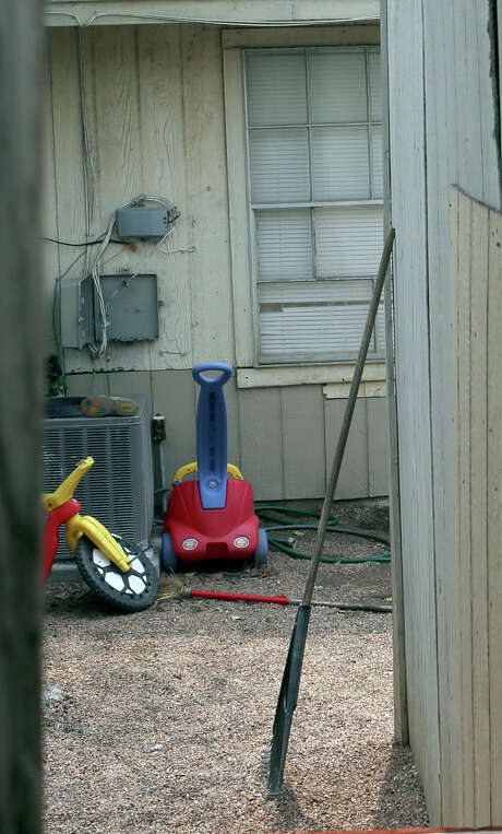 This is the back yard of the townhouse at 8105 Chipping in San Antonio, Texas, Friday, April 29, 2016, where children were allegedly chained up in the back yard. Authorities say they have arrested a woman who is the mother of six of eight children who were found unsupervised in the middle of the night at a San Antonio home. A spokesman for the Bexar County sheriff's office says the 34-year-old woman also was supposed to be looking after two other children who were found tied up in the backyard. (John Davenport/The San Antonio Express-News via AP) Photo: John Davenport / San Antonio Express-News / San Antonio Express-News