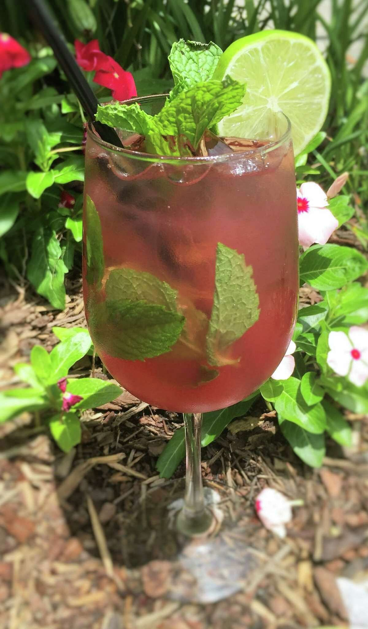 The Ouitea (passion fruit tea and vodka) from Ouisie's Table, Houston. Ouisie's Table is marking National Iced Tea Day, June 10, with iced tea cocktails.