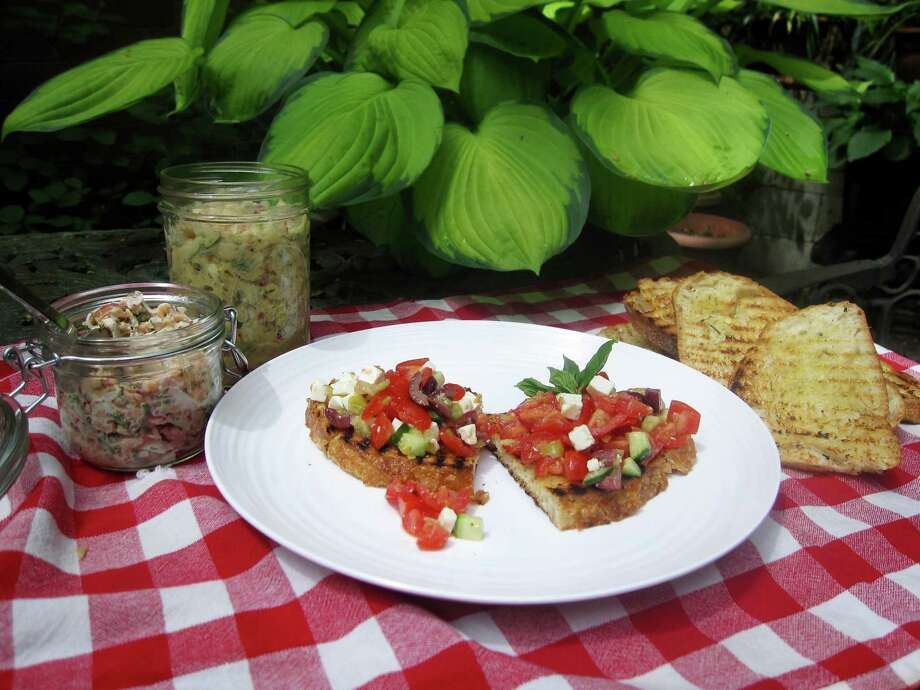 Jarred salmon and white bean salads, as well as chopped greek salad, make superb bruschetta toppings for a summer picnic. Photo: Sara Moulton, STF / AP