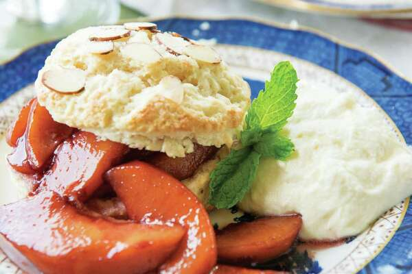 """Almond Buttermilk Shortcakes with Peaches Poached in Red Wine & White Chocolate Whipped Cream are featured in""""Julia Reed's South"""" (Rizzoli, $50)."""