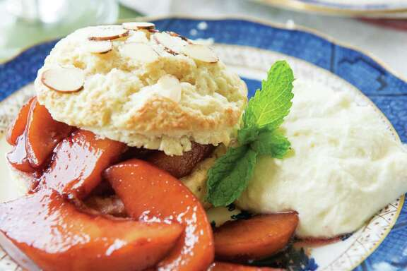 "Almond Buttermilk Shortcakes with Peaches Poached in Red Wine & White Chocolate Whipped Cream are featured in ""Julia Reed's South"" (Rizzoli, $50)."
