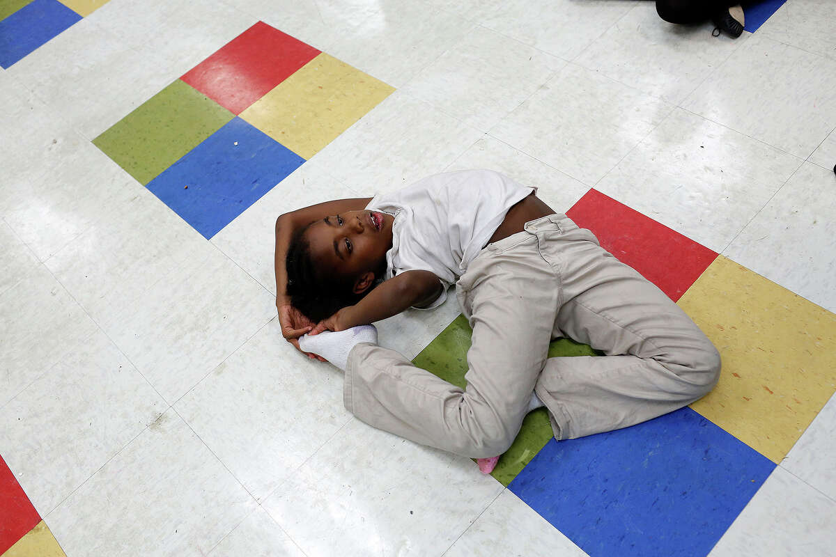 Lauren Thornton creates positions of her own during a ballet class at the Boys and Girls Club of San Antonio Eastside Branch on Oct. 2, 2015.