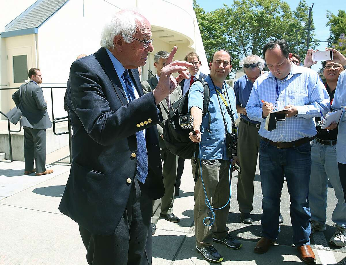 Presidential candidate Sen. Bernie Sanders talks to reporters before campaigning at Allen Temple Baptist Church in Oakland.