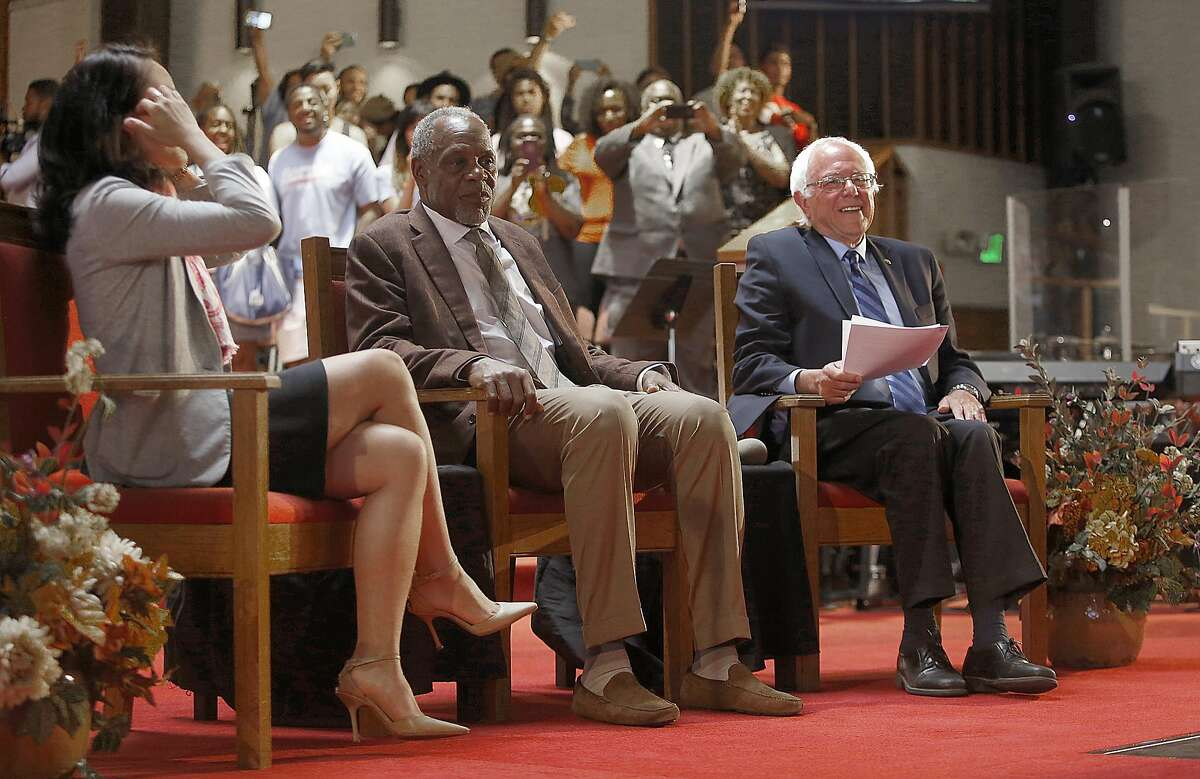 Sen. Bernie Sanders (right) sits with San Francisco supervisor Jane Kim (left) and Danny Glover (middle) during his campaign appearance at Allen Temple Baptist Church in Oakland.