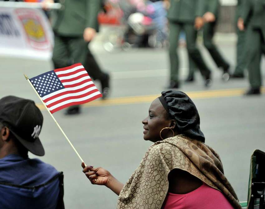 Selina Robertson of Albany watches the Albany Memorial Day Parade on Monday, May 30, 2016, in Albany, N.Y. (Paul Buckowski / Times Union)