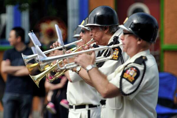 Members of the Yankee Doodle Band perform as they march in the Albany Memorial Day Parade on Monday, May 30, 2016, in Albany, N.Y.  (Paul Buckowski / Times Union)