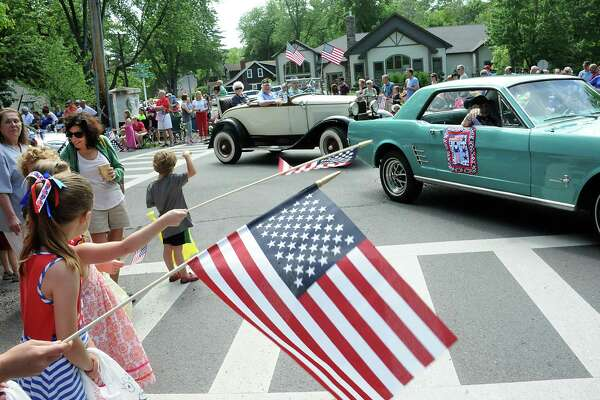 Spectators wave flags as they watch the Bethlehem Memorial Day parade on Adams St. on Monday, May 30, 2016 in Bethlehem, N.Y. (Lori Van Buren / Times Union)