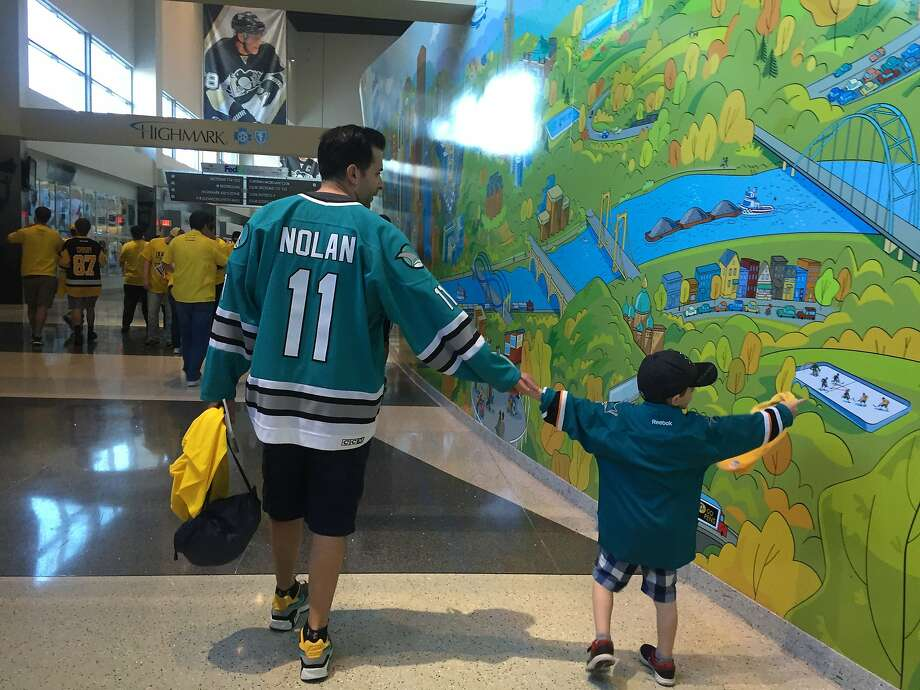 Anthony Calamita became a Sharks fan by virtue of a coin flip when he was 13 years old. A quarter century later, he and his son, Jack, 5, are attending the first Sharks' Stanley Cup Finals game in franchise history. Photo: Susan Slusser, The Chronicle