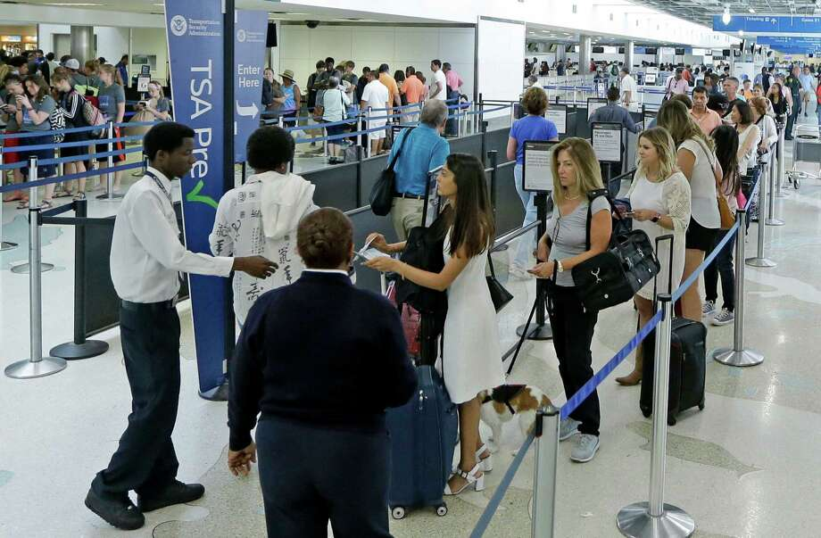 Travelers stand in line as they prepare to be screened a Transportation Security Administration checkpoint at Fort Lauderdale-Hollywood International Airport, Friday, May 27, 2016, in Fort Lauderdale, Fla. Memorial Day weekend, the unofficial start of summer vacations for many and a busy travel period, serves as a crucial test for the TSA. (AP Photo/Alan Diaz) Photo: Alan Diaz, STF / Copyright 2016 The Associated Press. All rights reserved. This material may not be published, broadcast, rewritten or redistribu