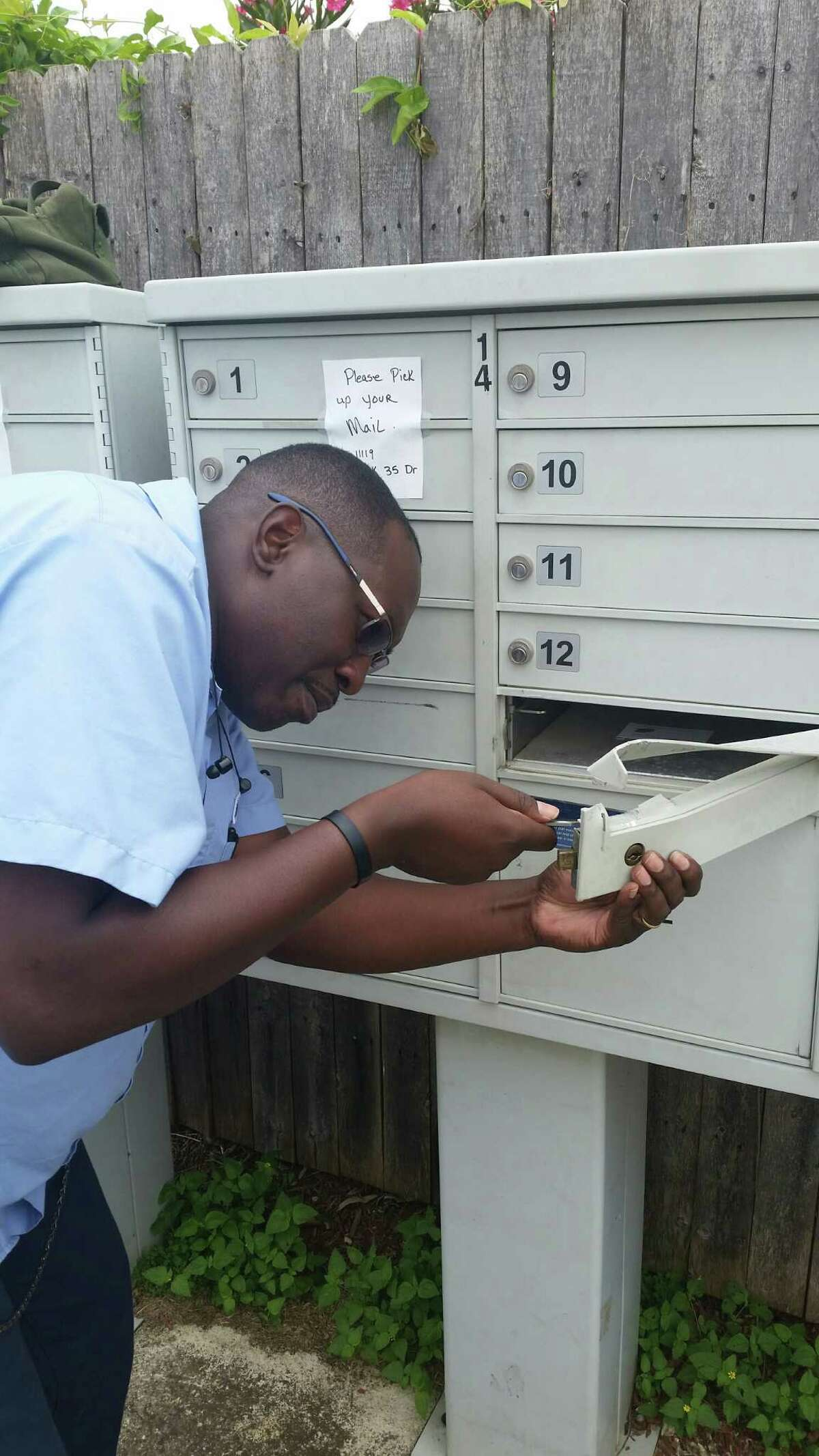 Postal employee Jerrod Williams repairs mailboxes in a San Antonio neighborhood that were broken into recently. The U.S. Postal Service said mail theft appears to be increasing.