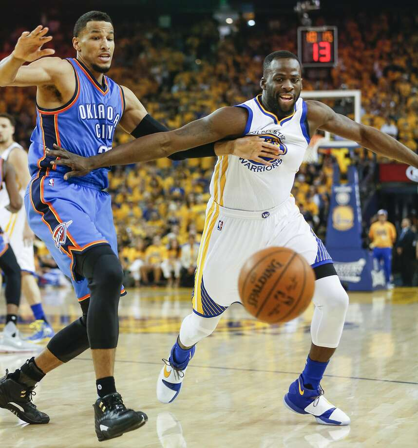 Thunder swingman Andre Roberson and Warriors forward Draymond Green fight for a loose ball in the first quarter of Game 7. Green had 11 points, nine rebounds and four assists . Photo: Scott Strazzante, The Chronicle