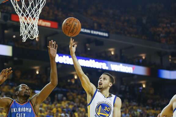 Golden State Warriors' Stephen Curry goes up for a layup against Oklahoma City Thunders' Kevin Durant in the first quarter during Game 7 of the NBA Western Conference Finals at Oracle Arena on Monday, May 30, 2016 in Oakland, Calif.