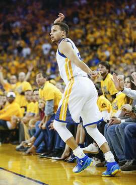 Golden State Warriors' Stephen Curry watches his three-pointer go in in the first quarter during Game 7 of the NBA Western Conference Finals at Oracle Arena on Monday, May 30, 2016 in Oakland, Calif.
