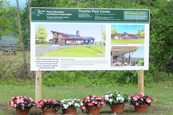 A drawing of the new Thacher Park Center sits where the visitor center will be constructed near the Indian Ladder Trail in Thacher State Park on Tuesday, June 2, 2015 in New Scotland, N.Y.  (Olivia Nadel/ Special to the Times Union)