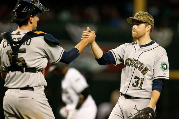 Houston Astros catcher Jason Castro (15) and Collin McHugh celebrates after defeating the Arizona Diamondbacks, 8-3, during a baseball game, Monday, May 30, 2016, in Phoenix. (AP Photo/Rick Scuteri)