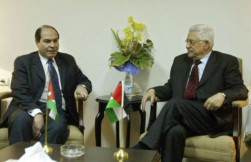 RAMALLAH, -: Hani Mulki, the new Prime Minister of Jordan, meets new Palestinian elected president Mahmud Abbas in the West Bank city of Ramallah 10 Janaury 2005. JAMAL ARURI/Getty Images ORG XMIT: 51923500