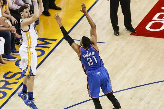 Golden State Warriors' Klay Thompson shoots a three pointer over Oklahoma City Thunders' Andre Roberson in the second quarter during Game 7 of the NBA Western Conference Finals at Oracle Arena on Monday, May 30, 2016 in Oakland, Calif.
