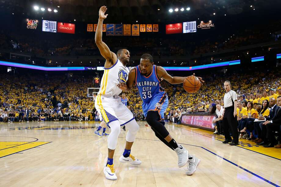 OAKLAND, CA - MAY 30:  Kevin Durant #35 of the Oklahoma City Thunder drives with the ball against Andre Iguodala #9 of the Golden State Warriors in Game Seven of the Western Conference Finals during the 2016 NBA Playoffs at ORACLE Arena on May 30, 2016 in Oakland, California. NOTE TO USER: User expressly acknowledges and agrees that, by downloading and or using this photograph, User is consenting to the terms and conditions of the Getty Images License Agreement.  (Photo by Ezra Shaw/Getty Images) Photo: Ezra Shaw, Getty Images