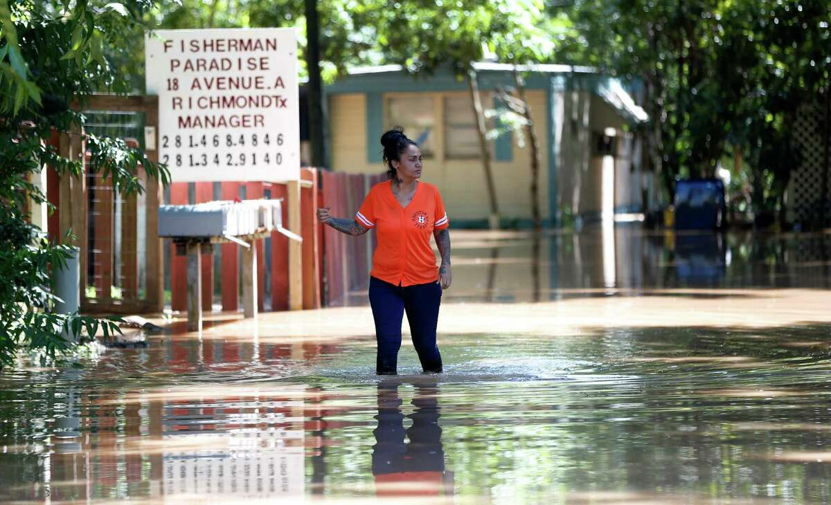 Georgette Barrera checks on the flooding at Fisherman's Paradise Trailer Park in Richmond after mandatory evacuations were issued for residents there.