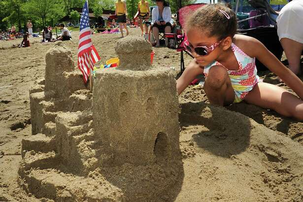 Savannah Skeeter, 7, of Guilderland works on her sand castle for the annual Memorial Day Sand Sculpture Contest at Grafton Lakes State Park on Monday, May 30, 2016 in Grafton, N.Y.  (Lori Van Buren / Times Union)