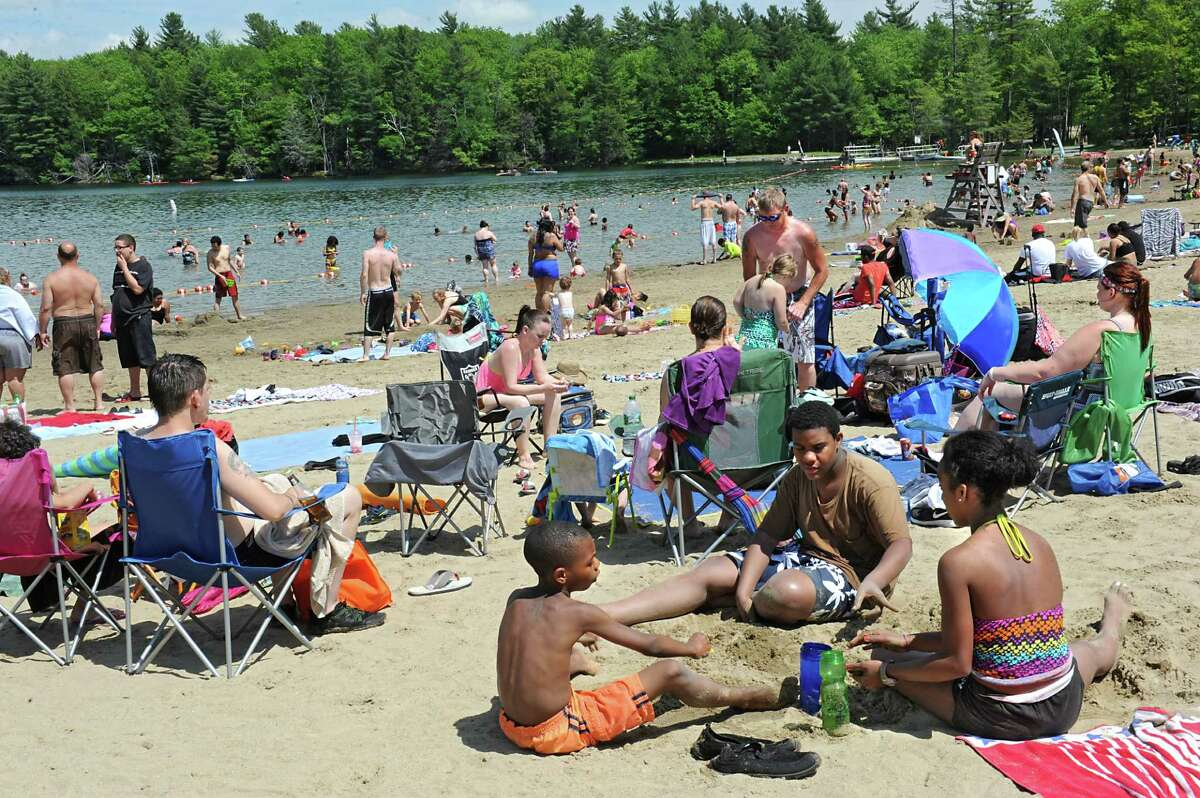 A hot Memorial Day brought a big crowd to the beach at Grafton Lakes State Park on Monday, May 30, 2016 in Grafton, N.Y. (Lori Van Buren / Times Union)