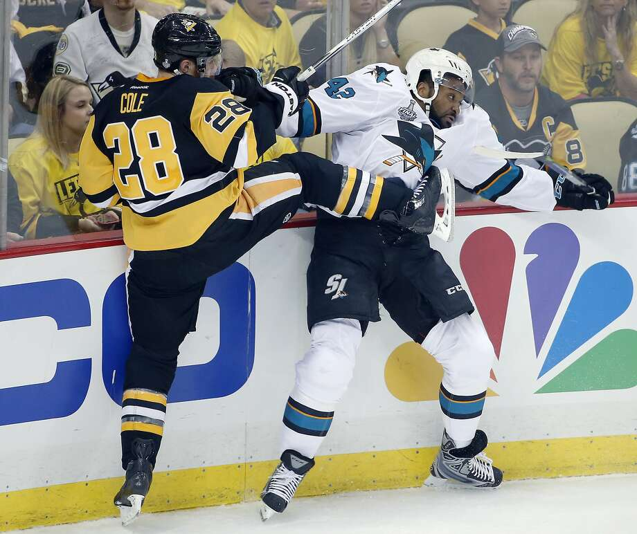 Pittsburgh's Ian Cole checks Joel Ward into the boards in the first period, which saw Pittsburgh build a 2-0 lead in Game 1 of the Stanley Cup Finals. Photo: Gene J. Puskar, Associated Press