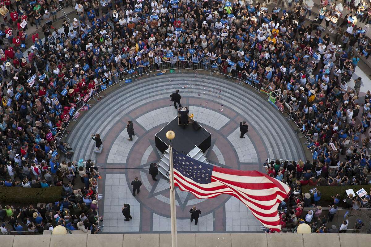 The Democratic Party 2016 presidential candidate, Senator Bernie Sanders addresses supporters during a campaign event at Frank Ogawa Plaza in Oakland, California, USA 30 May 2016, seen from inside Oakland City Hall. (Peter DaSilva/Special to The Chronicle)