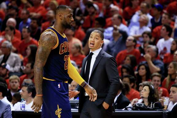 TORONTO, ON - MAY 27:  Head coach Tyronn Lue talks to LeBron James #23 of the Cleveland Cavaliers in the second half against the Toronto Raptors in game six of the Eastern Conference Finals during the 2016 NBA Playoffs at Air Canada Centre on May 27, 2016 in Toronto, Canada. NOTE TO USER: User expressly acknowledges and agrees that, by downloading and or using this photograph, User is consenting to the terms and conditions of the Getty Images License Agreement.  (Photo by Vaughn Ridley/Getty Images)