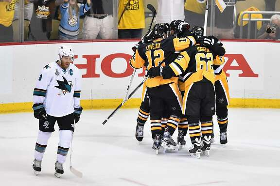 PITTSBURGH, PA - MAY 30:  Nick Bonino #13 of the Pittsburgh Penguins celebrates with teammates after scoring a third period goal against the San Jose Sharks as Joe Pavelski #8 reacts in Game One of the 2016 NHL Stanley Cup Final at Consol Energy Center on May 30, 2016 in Pittsburgh, Pennsylvania.  (Photo by Jamie Sabau/Getty Images)
