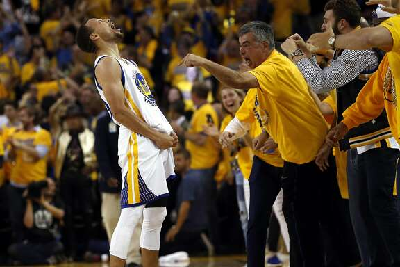 Golden State Warriors' Stephen Curry celebrates his 3-pointer in final minute of 96-88 win over Oklahoma City Thunder in Game 7 of NBA Playoffs' Western Conference finals at Oracle Arena in Oakland, Calif., on Monday, May 30, 2016.